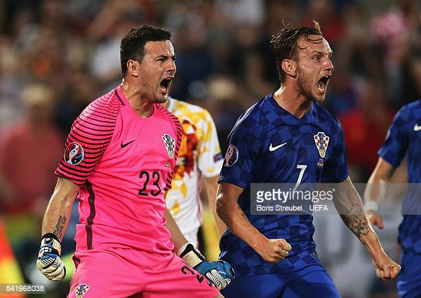 Danijel Subasic of Croatia celebrates saving the penalty by Sergio Ramos of Spain with Ivan Rakitic during the UEFA EURO 2016 Group D match between...