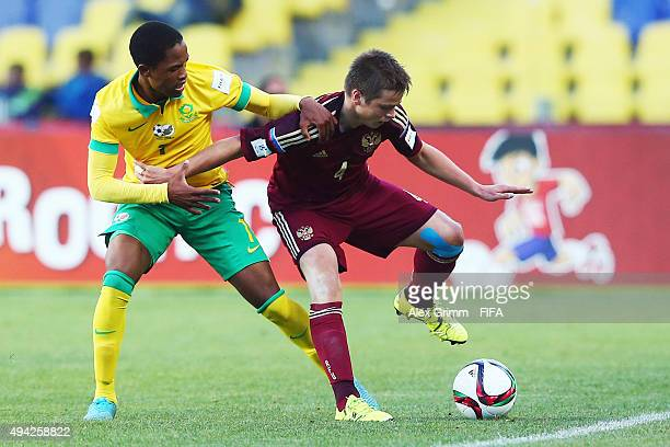Danil Krugovoi of Russia is challenged by Vuyo Mantije of South Africa during the FIFA U17 World Cup Chile 2015 Group E match between Russia and...