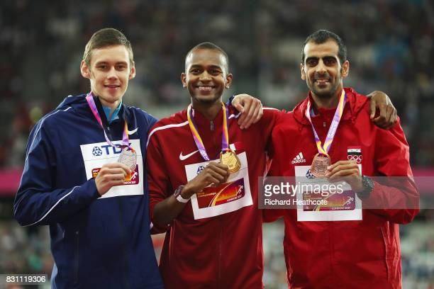 Danil Lysenko of the Authorized Neutral Athletes silver Mutaz Essa Barshim of Qatar gold and Majd Eddin Ghazal of Syrian Arab Republic pose with...