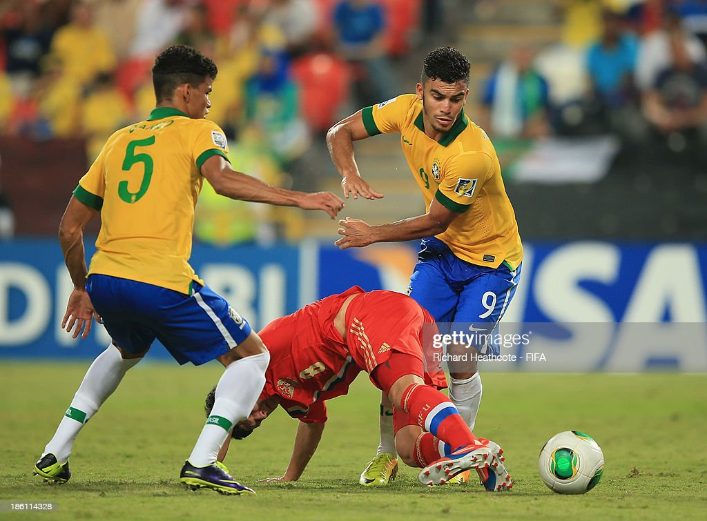 Danilo and Mosquito of Brazil battle past Ayaz Guliev of Russia during the FIFA U-17 World Cup UAE 2013 Round of 16 match between Brazil and Russia at the Mohamed Bin Zayed Stadium on October 28, 2013 in Abu Dhabi, United Arab Emirates.