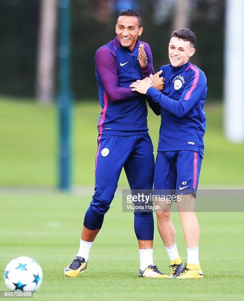 Danilo and Phil Foden joke during training at Manchester City Football Academy on September 11 2017 in Manchester England