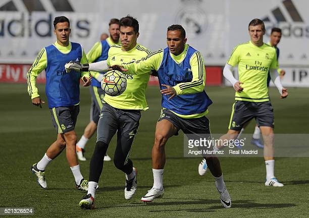 Danilo and Ruben Yanez of Real Madrid in action during a training session at Valdebebas training ground on April 15 2016 in Madrid Spain