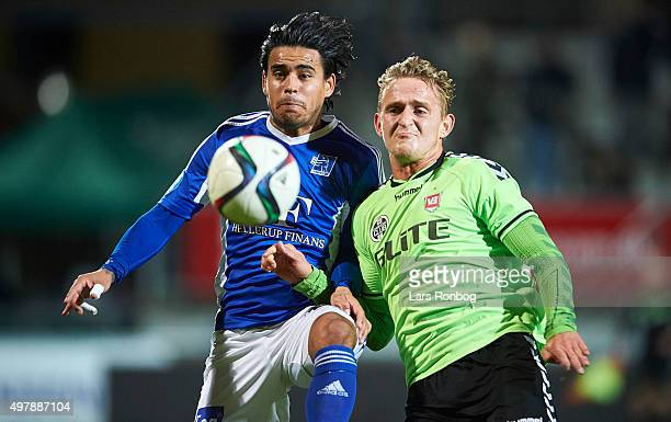 Danilo Arrieta of Lyngby Boldklub and Kristian Gaarde of Vejle Boldklub compete for the ball during the Danish 1th Division Bet25 Liga match between...