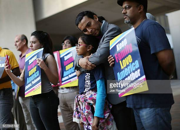 Danilo Balladares holds onto Dely Balladares as they join others during a vigil to support President Barack Obama's immigration executive action on...