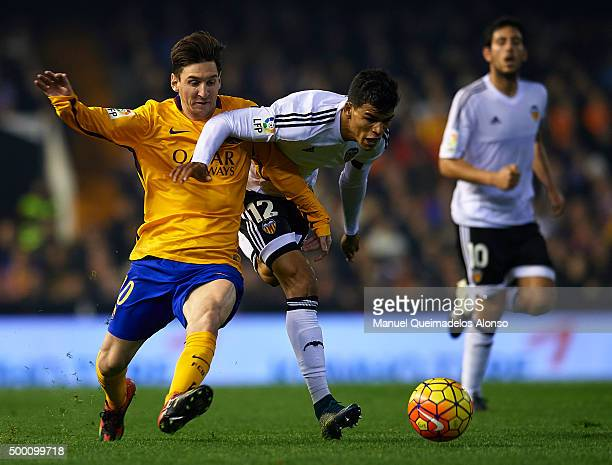 Danilo Barbosa of Valencia battle for the ball with Lionel Messi of Barcelona during the La Liga match between Valencia CF and FC Barcelona at Estadi...