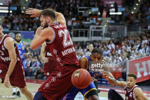 Danilo Barthel of Bayern Muenchen and Jarekious Bradley of Braunschweig battle for the ball during the easyCredit BBL Basketball Bundesliga match...