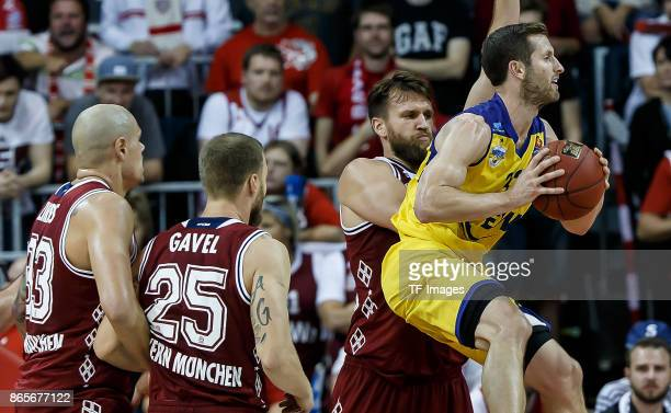 Danilo Barthel of Bayern Muenchen and Mickey McConnell of Oldenburg battle for the ball during the easyCredit BBL Basketball Bundesliga match between...