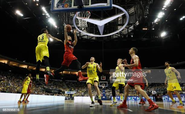 Danilo Barthel of FC Bayern Muenchen is challenged by Malcolm Miller of ALBA Berlin and Elmedin Kikanovic of ALBA Berlin during the easyCredit BBL...