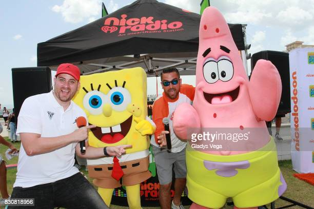 Danilo Beauchamp comedian and DJ Boogie of Nick Radio pose with Nickelodeon Characters as part of Worldwide Day of Play at Bahia Urbana Bay Side Park...