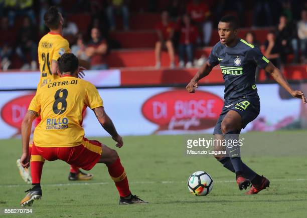 Danilo Cataldi of Benevento competes for the ball with Henrique Dalbert of Inter during the Serie A match between Benevento Calcio and FC...