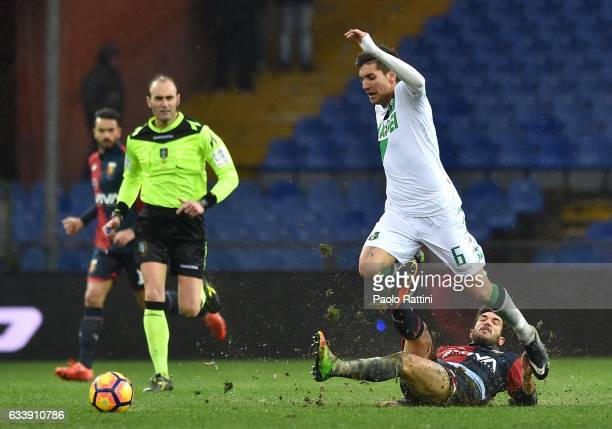 Danilo Cataldi of Genoa tackles Lorenzo Pellegrini of Sassuolo during the Serie A match between Genoa CFC and US Sassuolo at Stadio Luigi Ferraris on...