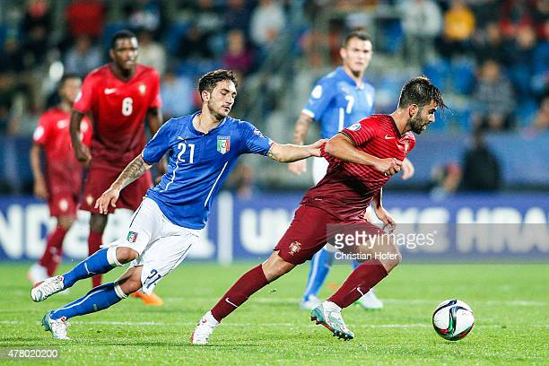 Danilo Cataldi of Italy competes for the ball with Sergio Oliveira of Portugal during the UEFA Under21 European Championship 2015 match between Italy...