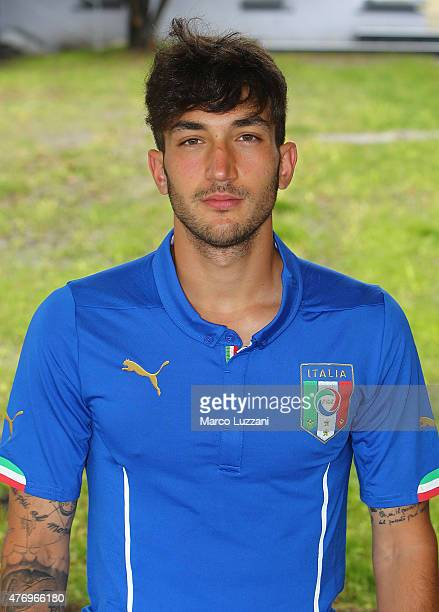 Danilo Cataldi of Italy U21 poses with the shirt during the official Italy U21 portrait session at the training ground on June 13 2015 in Appiano...