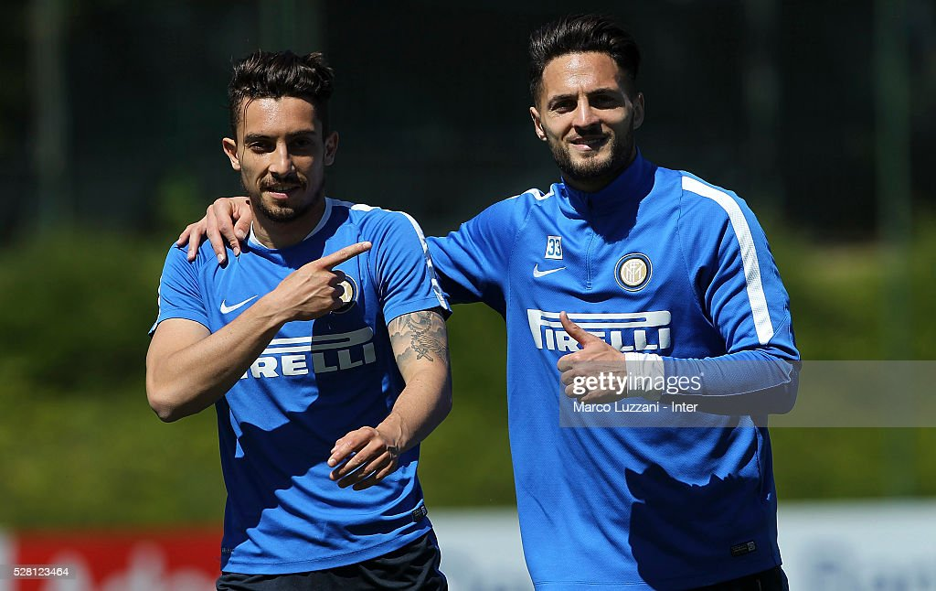 Danilo D Ambrosio (R) embraces <a gi-track='captionPersonalityLinkClicked' href=/galleries/search?phrase=Alex+Telles&family=editorial&specificpeople=10074392 ng-click='$event.stopPropagation()'>Alex Telles</a> (L) of FC Internazionale Milano during the FC Internazionale training session at the club's training ground 'La Pinetina' on May 4, 2016 in Como, Italy.