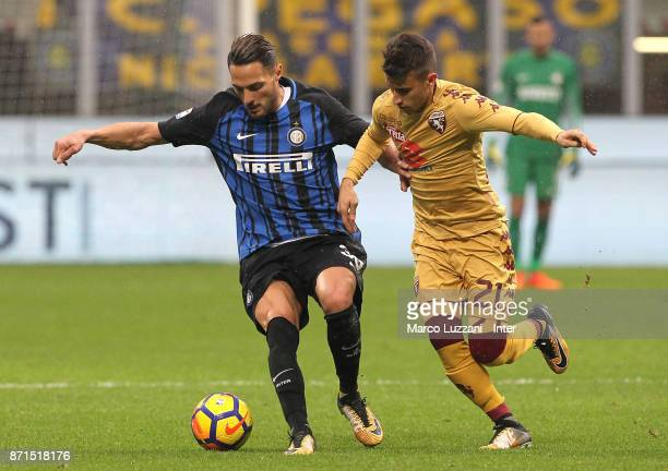 Danilo D Ambrosio of FC Internazionale is challenged by Alejandro Berenguer of Torino FC during the Serie A match between FC Internazionale and...