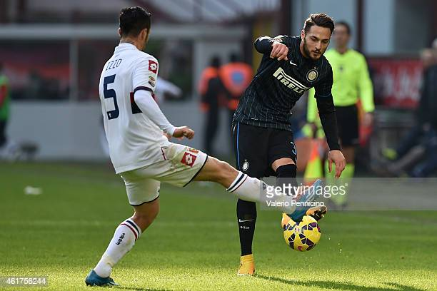 Danilo D Ambrosio of FC Internazionale Milano is challenged by Armando Izzo of Genoa CFC during the Serie A match between FC Internazionale Milano...