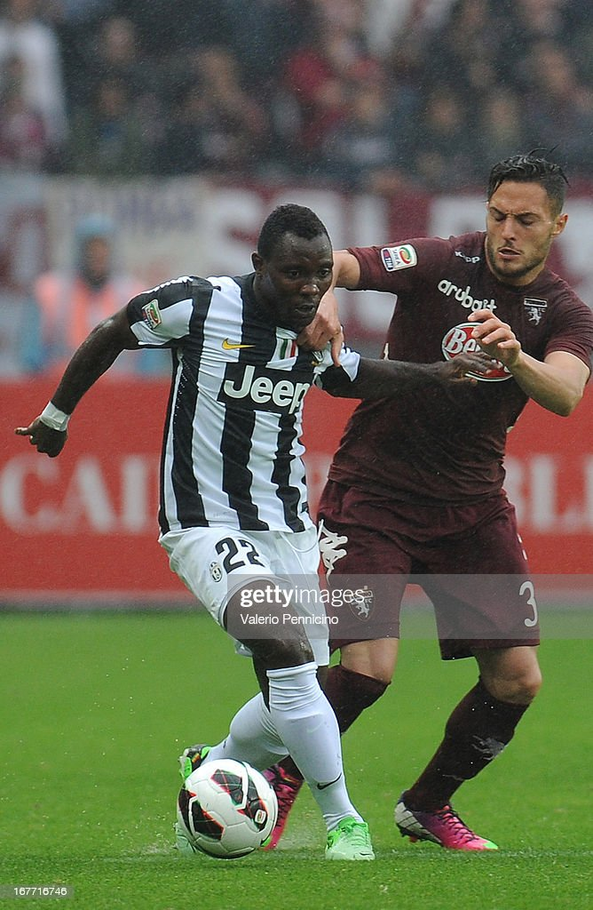 Danilo D Ambrosio (R) of Torino FC competes with Kwadwo Asamoah of Juventus during the Serie A match between Torino FC and Juventus at Stadio Olimpico di Torino on April 28, 2013 in Turin, Italy.