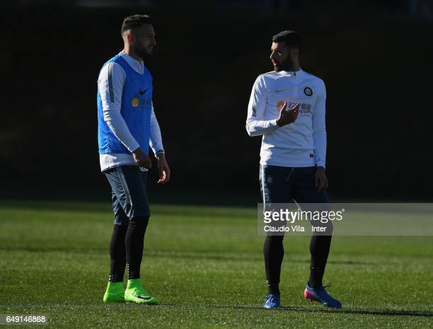 Danilo D'Ambrosio and Antonio Candreva of FC Internazionale look on during a FC Internazionale training session at Suning Training Center at Appiano...
