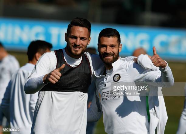 Danilo D'Ambrosio and Antonio Candreva pose for a photo prior to the FC Internazionale training session at Suning Training Center at Appiano Gentile...