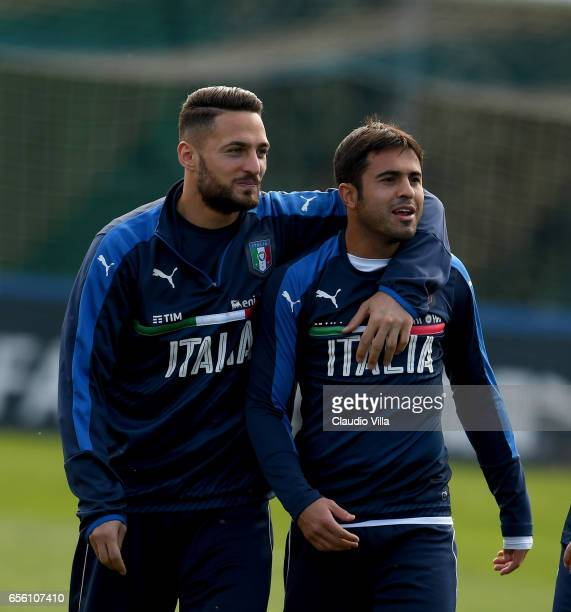 Danilo D'Ambrosio and Eder of Italy chat prior to the training session at the club's training ground at Coverciano on March 21 2017 in Florence Italy