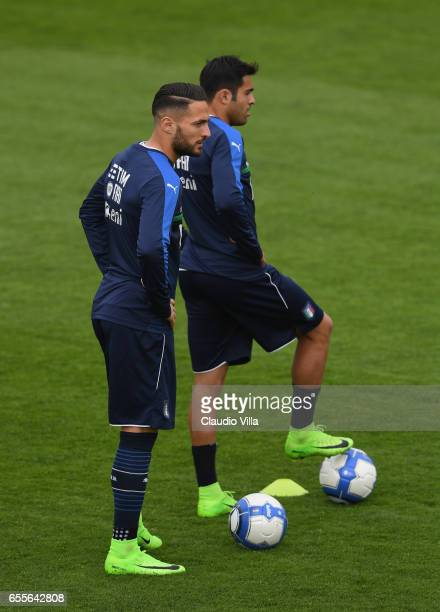 Danilo D'Ambrosio and Eder of Italy look on during the training session at the club's training ground at Coverciano on March 20 2017 in Florence Italy