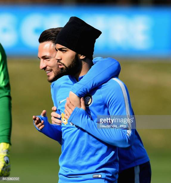 Danilo D'Ambrosio and Gabriel Barbosa Almeida chat prior to the training session at Suning Training Center at Appiano Gentile on March 11 2017 in...