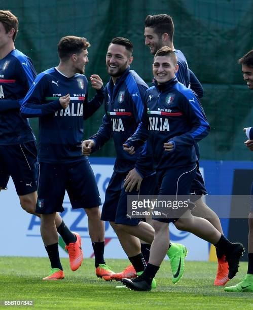 Danilo D'Ambrosio and Marco Verratti of Italy chat during the training session at the club's training ground at Coverciano on March 21 2017 in...