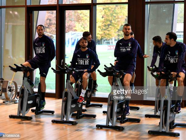 Danilo D'Ambrosio Lorenzo Insigne Leonardo Spinazzola and Davide Zappacosta of Italy look on during a training session at Italy club's training...