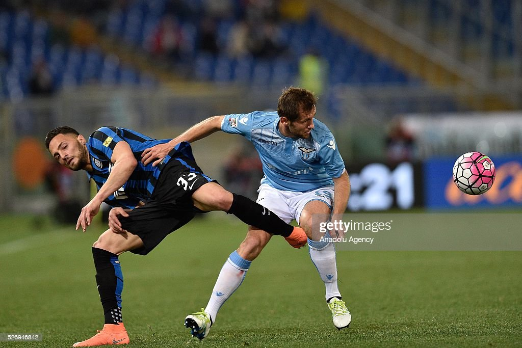 Danilo D'ambrosio (L) of FC Inter competes with Senad Lulic (R) of SS Lazio during the Serie A match between SS Lazio and FC Internazionale Milano at Stadio Olimpico on May 1, 2016 in Rome, Italy.
