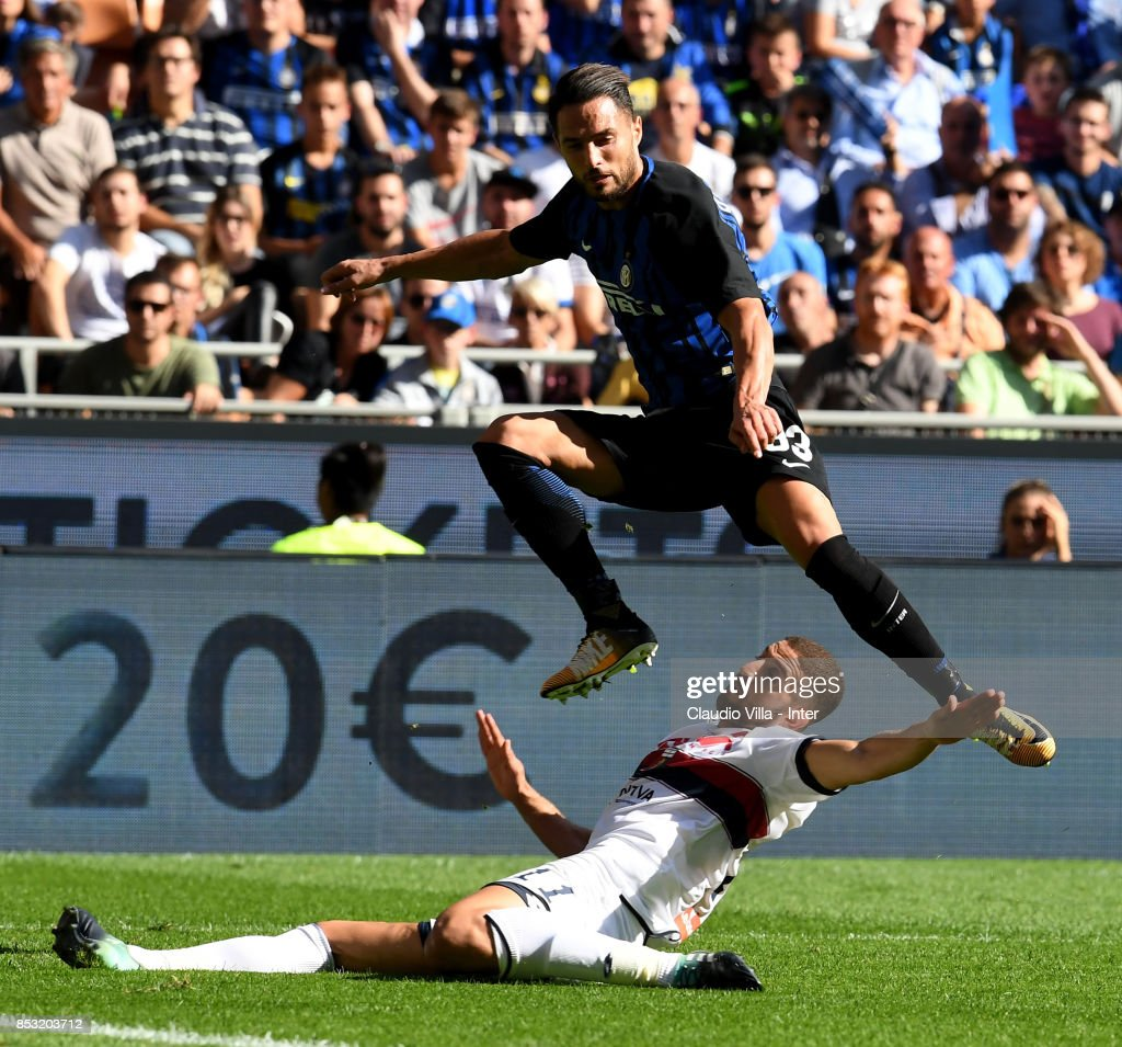 Danilo D'Ambrosio of FC Internazionale (L) and Adel Taarabt of Genoa CFC compete for the ball during the Serie A match between FC Internazionale and Genoa CFC at Stadio Giuseppe Meazza on September 24, 2017 in Milan, Italy.