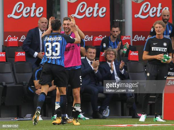 Danilo D'Ambrosio of FC Internazionale celebrates with Roberto Gagliardini after scoring the opening goal during the Serie A match between FC...
