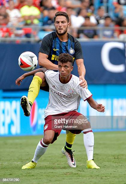 Danilo D'Ambrosio of FC Internazionale challenges Timothy Tillman of FC Bayern Munich for the ball during an International Champions Cup match at...