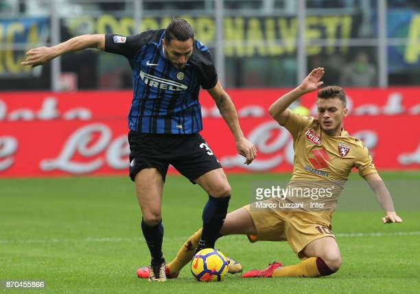 Danilo D'Ambrosio of FC Internazionale competes for the ball with Adem Ljajic of Torino FC during the Serie A match between FC Internazionale and...