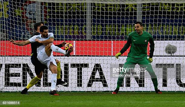 Danilo D'Ambrosio of FC Internazionale competes for the ball with Sergio Pellissier of AC ChievoVerona during the Serie A match between FC...