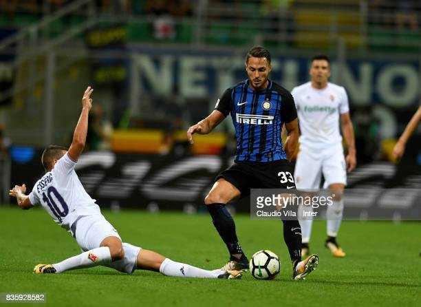 Danilo D'Ambrosio of FC Internazionale competes for the ball with Valentin Eysseric of ACF Fiorentina during the Serie A match between FC...