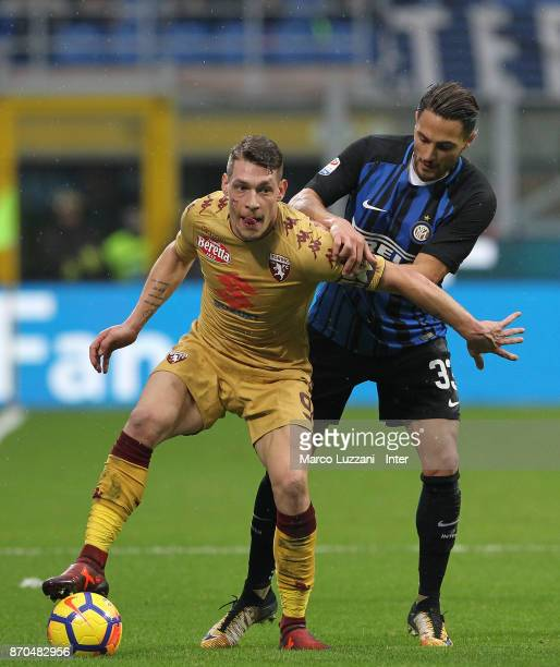 Danilo D'Ambrosio of FC Internazionale competes for the ball with Andrea Belotti of Torino FC during the Serie A match between FC Internazionale and...