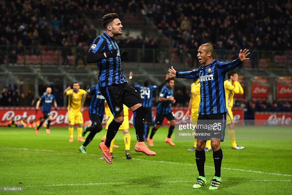 Danilo D'Ambrosio of FC Internazionale Milano celebrates after scoring the opening goal with team mate Joao Miranda during the Serie A match between...