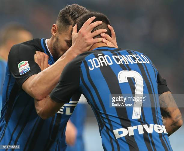 Danilo D'Ambrosio of FC Internazionale Milano celebrates the victory with his teammate Joao Cancelo at the end of the Serie A match between FC...