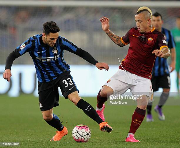Danilo D'Ambrosio of FC Internazionale Milano competes for the ball with Radja Nainggolan AS Roma during the Serie A match between AS Roma and FC...