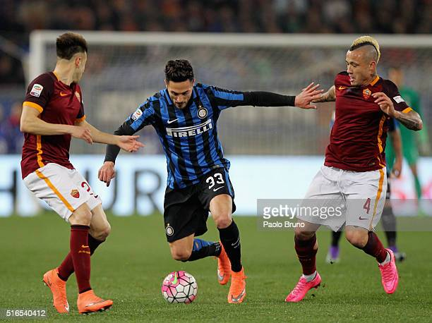 Danilo D'Ambrosio of FC Internazionale Milano competes for the ball with AS Roma players during the Serie A match between AS Roma and FC...