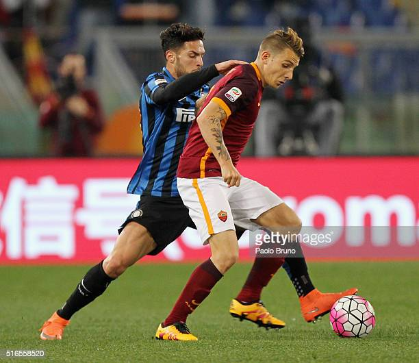 Danilo D'Ambrosio of FC Internazionale Milano competes for the ball with Lucas Digne AS Roma during the Serie A match between AS Roma and FC...