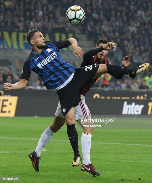 Danilo D'Ambrosio of FC Internazionale Milano competes for the ball with Andre Silva of AC Milan during the Serie A match between FC Internazionale...