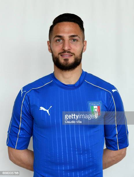 Danilo D'Ambrosio of Italy poses during the official portrait session prior to the training session at the club's training ground at Coverciano on...