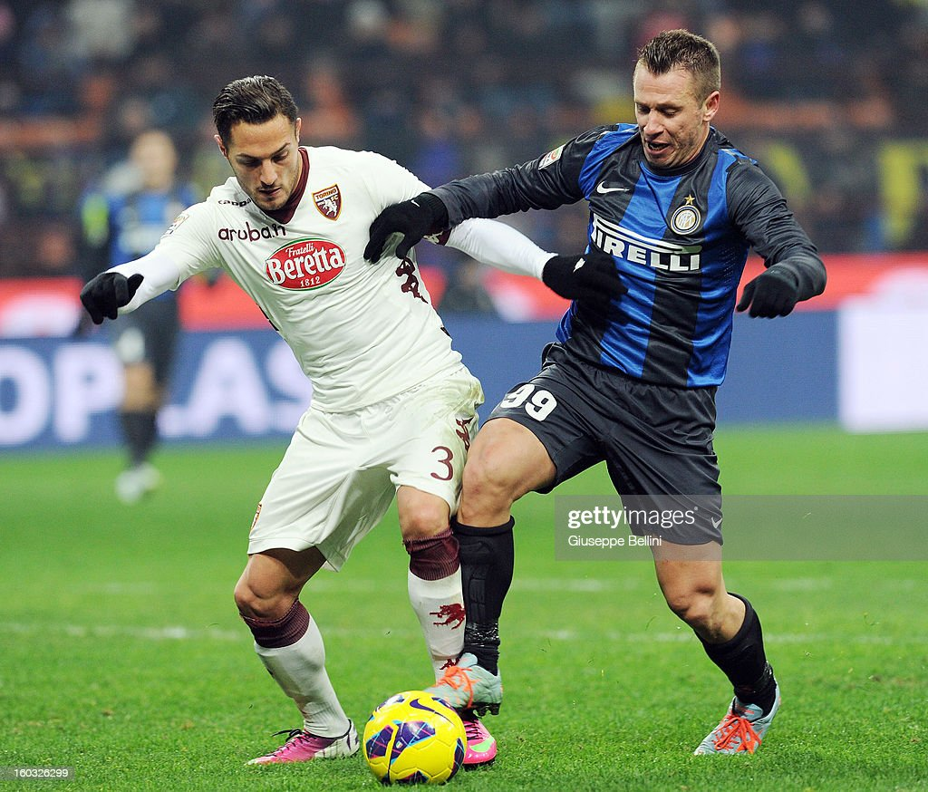 Danilo D'Ambrosio (L) of Torino challenges Antonio Cassano of Inter during the Serie A match between FC Internazionale Milano and Torino FC at San Siro Stadium on January 27, 2013 in Milan, Italy.