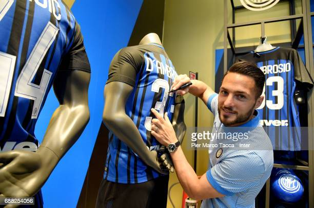 Danilo D'Ambrosio signs a new FC Internazionale jersey in store as the FC Internazionale new 2017/18 kit is unveiled at Club Store on May 25 2017 in...