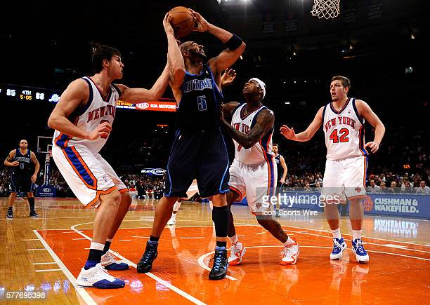Danilo Gallinari Al Harrington and David Lee of the New York Knicks guard Carlos Boozer of the Utah Jazz in the second half at Madison Square Garden...