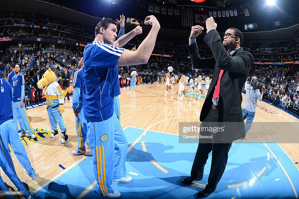 Danilo Gallinari #8 and JaVale McGee #34 of the Denver Nuggets greet each other in pre-game announcements before the game against the Indiana Pacers on January 28, 2013 at the Pepsi Center in Denver, Colorado.
