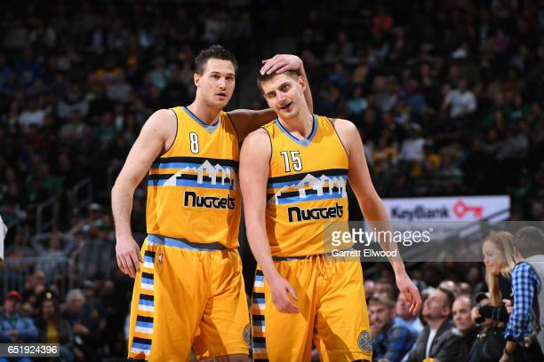 Danilo Gallinari and Nikola Jokic of the Denver Nuggets are seen during the game against the Boston Celtics on March 10 2017 at the Pepsi Center in...