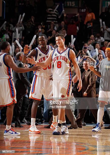 Danilo Gallinari Earl Barron and Chris Duhon of the New York Knicks celebrate a basket by Gallinari near then end of a Knicks' win over the Boston...