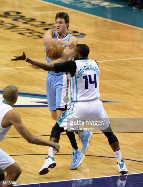 Danilo Gallinari of Denver Nuggets in action against Michael KiddGilchrist of Charlotte Hornets during the NBA match between Denver Nuggets vs...